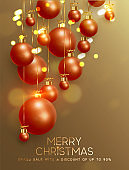 Christmas background with balls of red-gold balls and glitter bokeh lights. Festive Xmas decoration bauble, hanging on the ribbon.