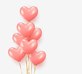 Balloons group realistic in shape pink heart with gold ribbon.