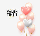 Happy Valentines Day. Realistic Balloons group in shape heart with gold ribbon.