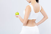 Back view portrait asian woman holding green apple fruit and beautiful body diet with fit isolated on white background, girl weight slim with cellulite or calories, health and wellness concept.