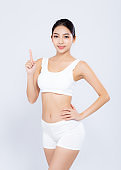 Portrait young asian woman smiling beautiful body diet with fit and finger pointing something isolated on white background, model girl weight slim with cellulite or calories, health and wellness concept.