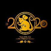 Golden metallic rat with a coin in its paws. Year of the Rat 2020 in the Chinese calendar. Golden symbol on black. Beautiful New Year card with the symbol of the year Golden Rat.