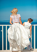 Bride and Her Daughter Looking at View