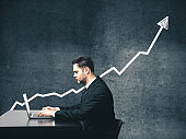 Businessman looking on stock market infographic.