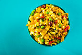 Indian Snacks: Traditional Indian deep fried salty dish called chivda or mixture or farsan made of gram flour and mixed with dry fruits and roasted nuts with salt, pepper, pulses, spice and green peas