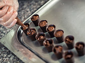 Confectioner makes shells for chocolate pieces