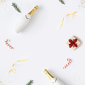 Trendy Christmas pattern made with various winter and New Year objects on bright background.
