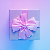 Gift box in vibrant bold gradient holographic colors.