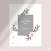 Happy mothers day greeting card, invitation. Floral frame made of magnolia flowers, petals and branches. Shadow overlay, sunlight elegant design. Pink stock vector illustration background.