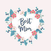 Mothers day greeting card, invitation. Best mom lettering text. Heart background with wreath of hand drawn leaves and flowers. Brush script, calligraphic design. Floral stock vector illustration.