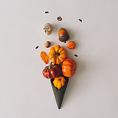 Icecream made with black ice-cream cone pumpkins and Halloween things.