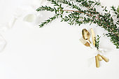 Festive wedding, birthday table setting with golden cutlery, eucalyptus parvifolia, silk ribbon and milk pitcher on white table background. Rustic restaurant menu concept. Flat lay, top view. Empty space.