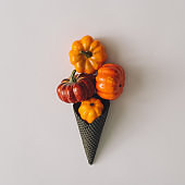 Icecream made with black ice-cream cone and pumpkins.