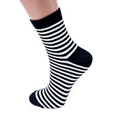 white and black  socks in the cage and stripes or polka dot on a white isolated background