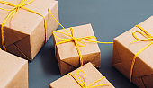 holidays shopping beige gift boxes yellow cord