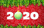 Merry Christmas and Happy New Year 2020 banner. Holiday vector illustration with Christmas tree branches and Christmas ball on red background