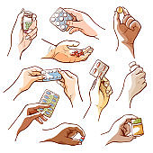 Human hands holding pills, medicines and drugs