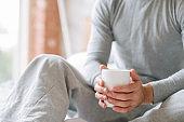 comfort morning beverage man sit hold cup