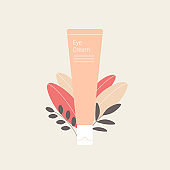 Eye cream tube with plant leaves.