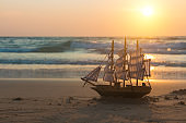 Sailboat at sea shore at sunset in the evening. Andaman sea, Thailand. Sea cruise.
