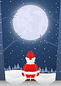 Santa claus standing alone on christmas night with big moon