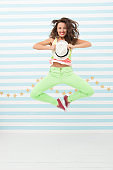 Glamour fashion model. Crazy girl in colorful sporty clothes. Happy and stylish beautiful woman. Hip hop woman dancer. Fashion and beauty. Hipster girl. Confident in her choice. girl jump in yoga pose