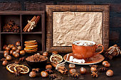 Hot chocolate drink with spices on dark background