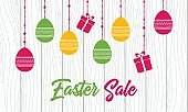 Easter sale. Vector banner template with hanging easter eggs