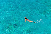 Woman floating in immaculate sea