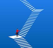 Businessman climbing higher stairs