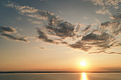 Beautiful view of the sea and sunset. Aerial view from flying drone of a beautiful nature landscape with dramatic clouds sunset sky and views of the sea surface. Postcard view. Nature