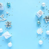 Christmas background with decorations and gift boxes on blue background