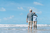 Asian couple senior elder retire resting relax beach honeymoon family together happiness people lifestyle
