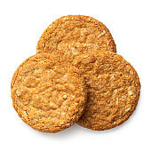 Three crunchy oat and wholemeal biscuits isolated on white. Top view.