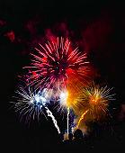 Multicolor fireworks display on black background