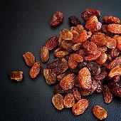 Organic Raisins. Black Background