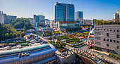 Busy city streets pedestrians traffic rooftop panorama Seoul South Korea