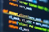 Program code on screen of laptop. Coding process. Software development. Developer programming web application server