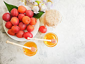 fresh peach on a plate, honey, iris flower on a gray concrete background
