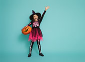 little witch on turquoise background
