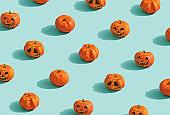 Pumpkins lanterns on turquoise background.
