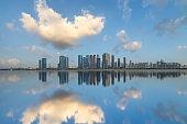 modern city waterfront downtown skyline under blue sky,China