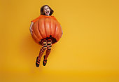 little girl in pumpkin costume