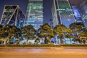 Empty asphalt road through modern city in Shanghai, China