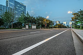 City empty road with modern buildings background