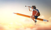 child flying on a pencil