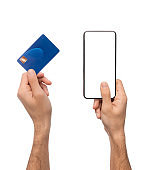 Credit card and smartphone with blank screen in male hands