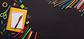 School and office stationery on chalk board background