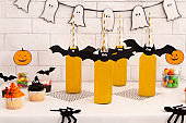 Halloween spooky drinks and colored cupcakes for children