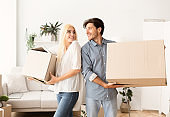 Confused Couple Carrying Moving Boxes Ready For Relocation Or Separation